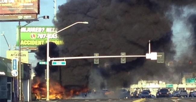 Man arrested after 2 dead, 4 injured in Las Vegas bus fire