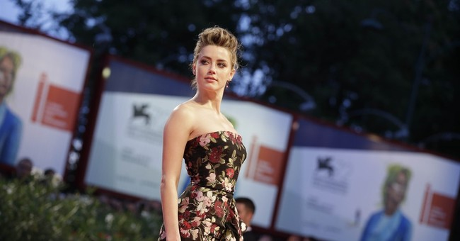 Redmayne impresses in transgender story 'The Danish Girl'