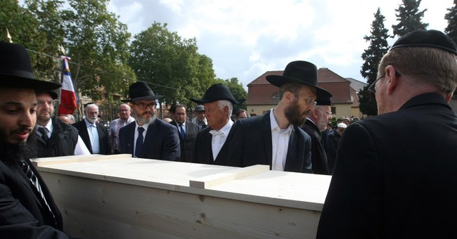 France buries Holocaust victims' secretly conserved remains