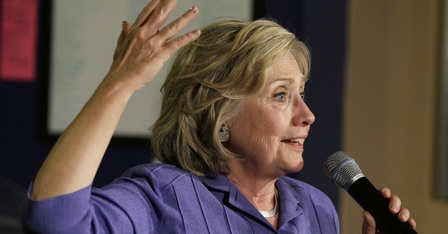 Clinton back in Iowa, promises to take on Republicans