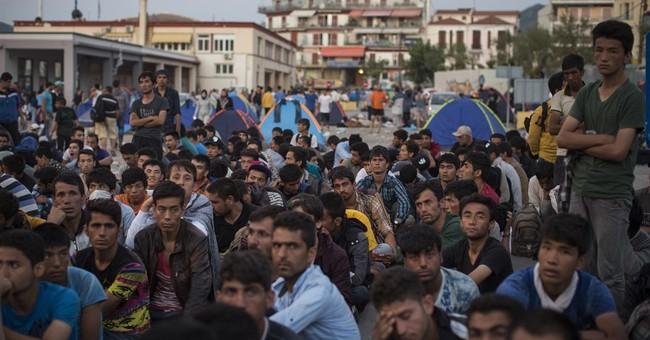 The Latest: Austria to resume border limits on migrants
