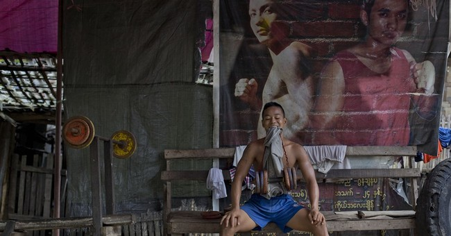 AP PHOTOS: Myanmar athletes train amid traffic