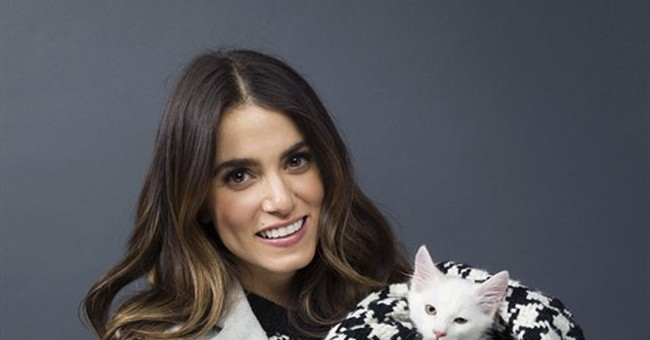 Nikki Reed coy about love for Somerhalder, but not animals
