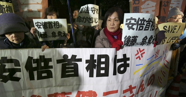 Japan working to gain IS hostage's release, analyzing video
