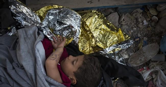 Greek island overwhelmed by stranded migrants, despair