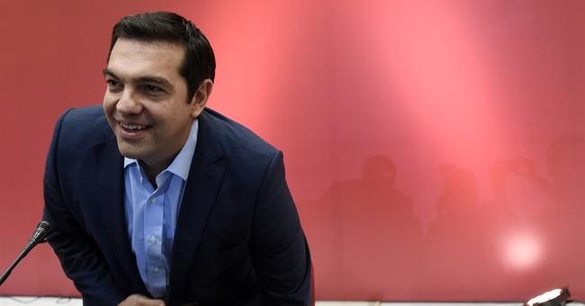 Greek former PM Tsipras seeks absolute majority in election