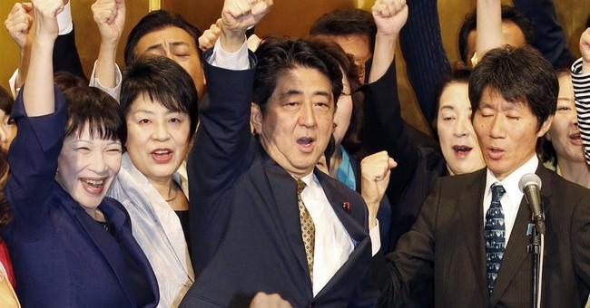 Japan's prime minister, unopposed, named party president