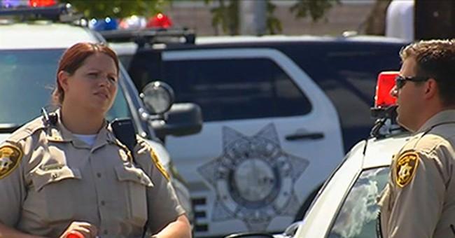 Las Vegas officer injured after gunman fires on SUV