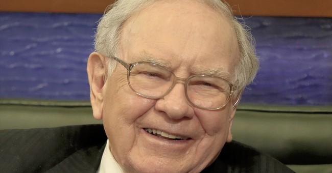 Buffett plies volatile waters, digs in on IBM