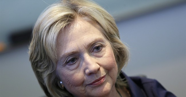 Clinton says private email was a mistake, says she's sorry