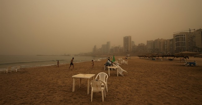 Unseasonal sandstorm sweeps across Mideast