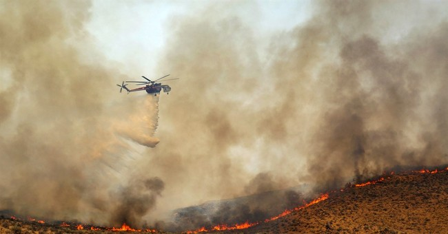 Social media lit up by firefighters' pics of the West ablaze