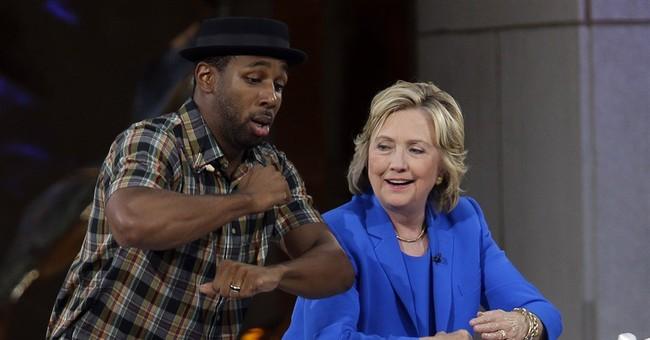 Clinton visits 'Ellen,' wins DeGeneres' vote of approval