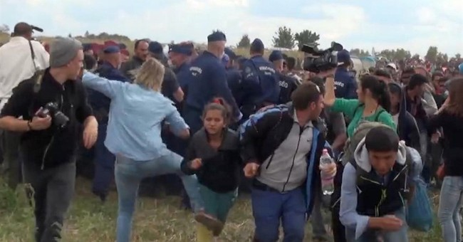 Camerawoman in Hungary fired for kicking, tripping migrants