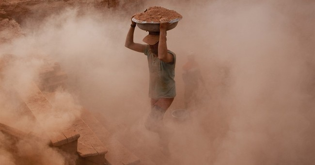 Image of Asia: Working at a brick kiln in Kashmir