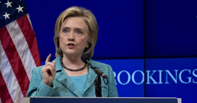 Clinton threatens military action if Iran breaks deal