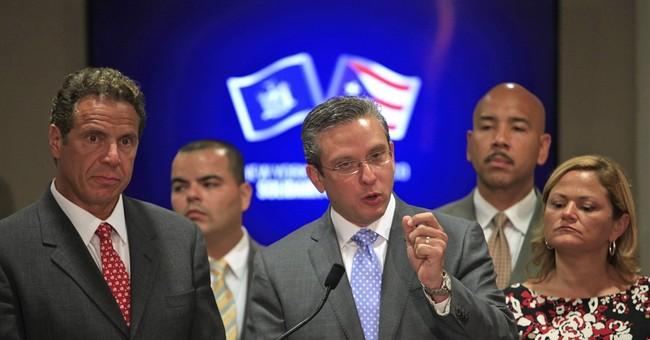 Puerto Rico unveils fiscal reform plan, braces for cuts