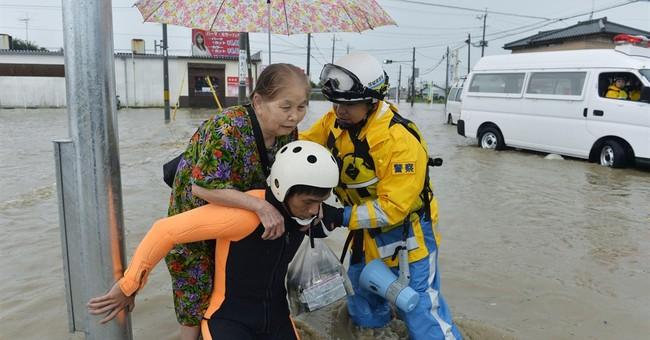 1 missing in Japan floods as heavy rain overflows rivers