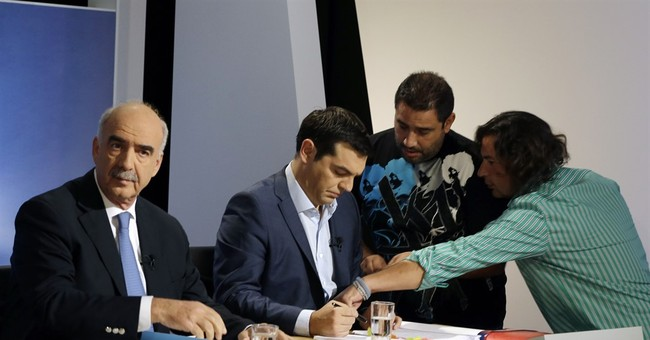 Greece's Tsipras admits mistakes in debate ahead of poll