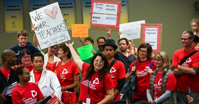 The Latest: No classes Thursday as Seattle strike continues