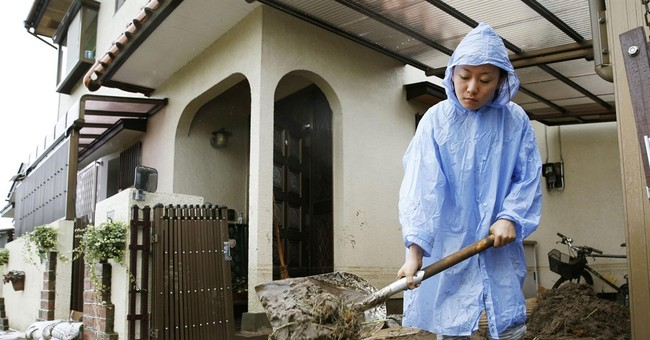 1 missing in Japan floods as heavy rain overflows rivers