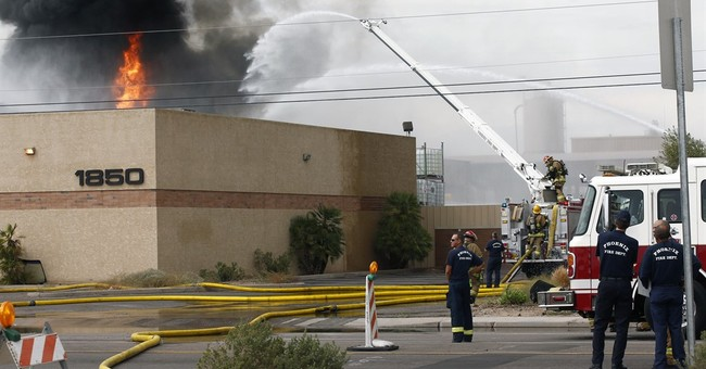 Motor-oil drums explode in fire south of downtown Phoenix