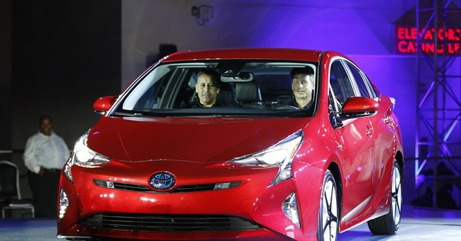 Toyota rolls out new Prius hybrid as gas prices tumble