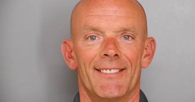 Son says slain suburban police officer did not kill himself