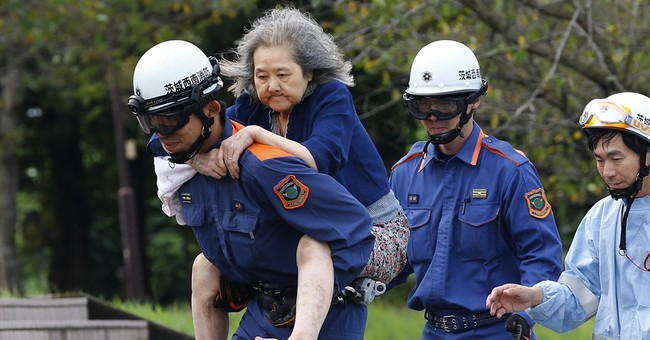 Rescuers search for missing after Japanese city flooded