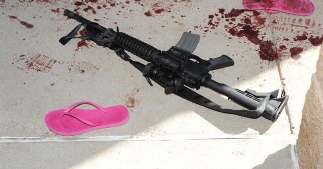 New photos show theater shooter's explosive booby traps