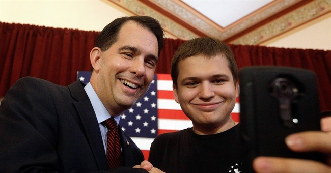 Wisconsin's Walker promises to fight federal unions