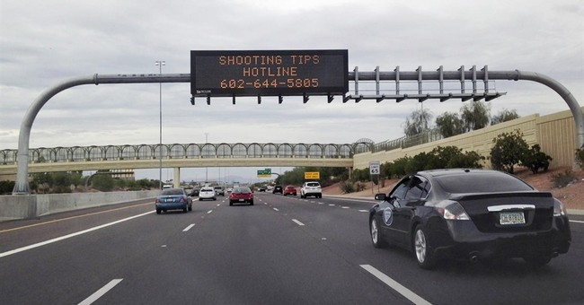 Arizona police swarm store, detain man in freeway shootings