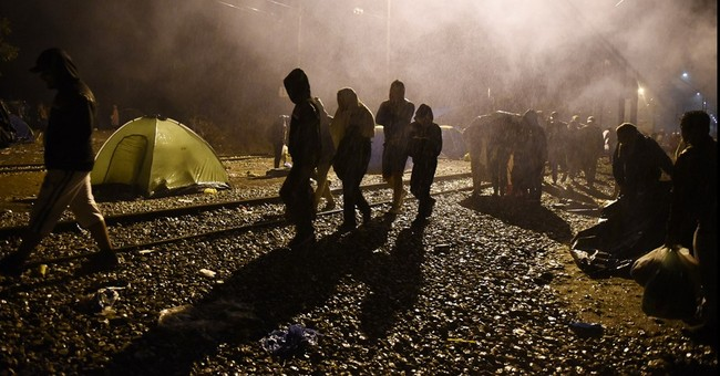 Migrants' long and winding road to Europe turns cold, muddy
