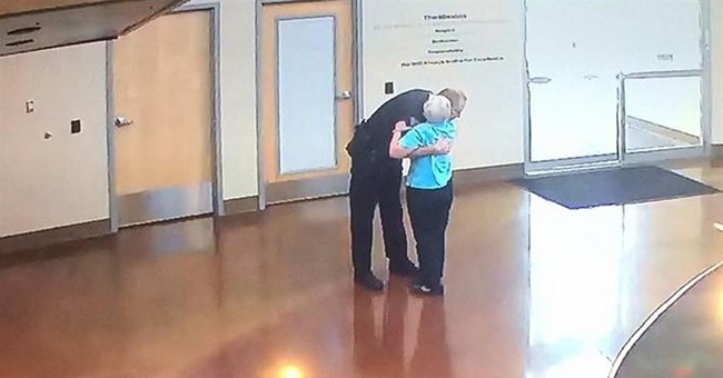 Woman stops by Colorado police station to hug officer