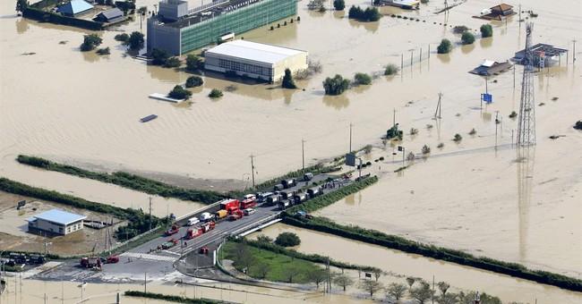 Shocked city assesses flood damage in Japan; 22 missing