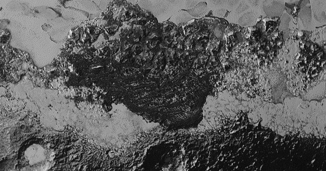 Newest Pluto pictures show jumbled mountains, possible dunes