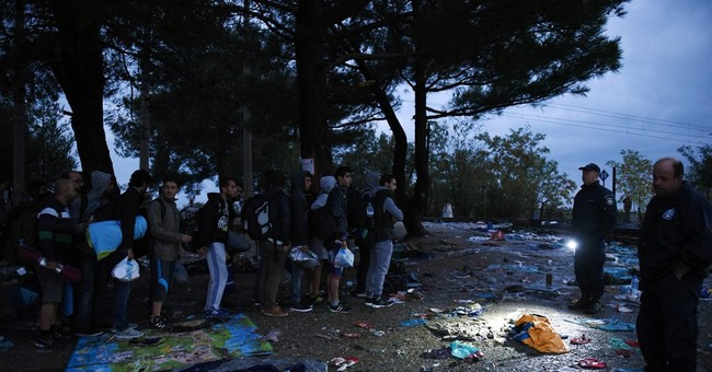 AP PHOTOS: By rail, by bus, on foot, refugees keep coming