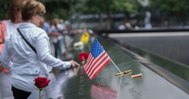 The Latest: Obama visits with troops for 9/11 commemorations
