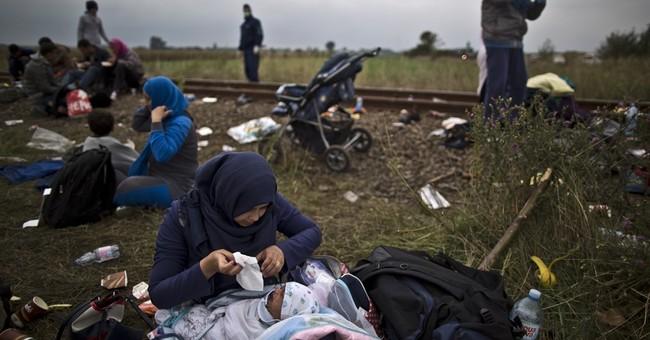 The Latest: EU to assess economic impact of migrant crisis