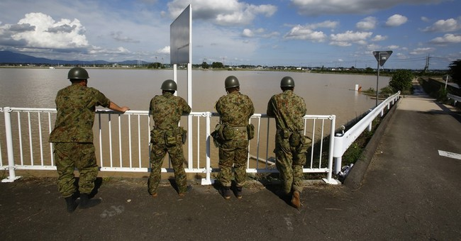 Japanese floods stretch limits of elaborate water networks