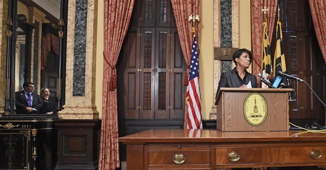 Dogged by critics, Baltimore mayor drops re-election bid