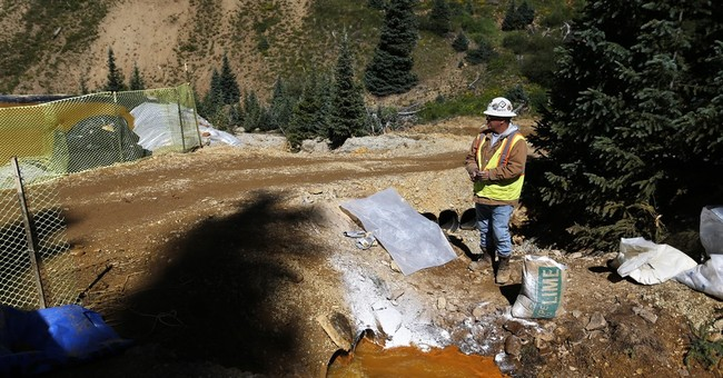 AP Exclusive: After spill, work suspended at 10 mine sites