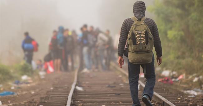 Some 10,000 migrants flood into Germany, enjoy warm welcome
