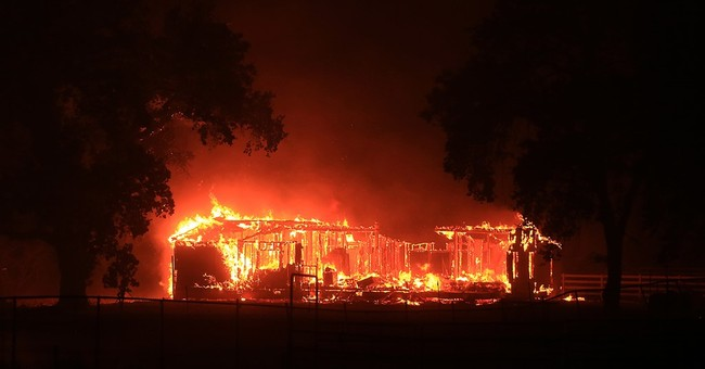 The Latest: California fire destroys 400 homes, businesses