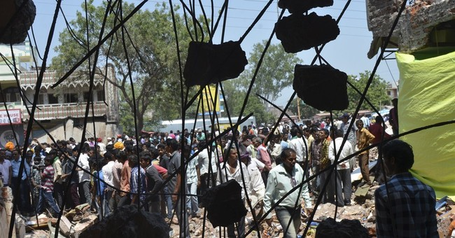 Indian police look for man blamed for blast that killed 90