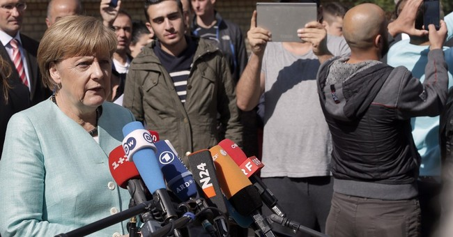 Migrant crisis adjusts Merkel's image, but style unchanged