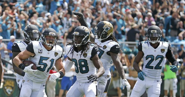 Panthers rally around Kuechly, beat Jaguars 20-9 in opener