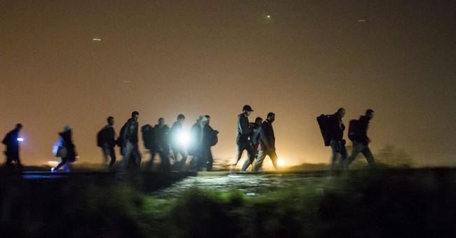 The Latest: EU fails to agree plan to share 120,000 refugees