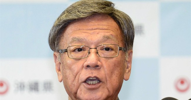 Okinawa leader threatens to revoke approval to move US base