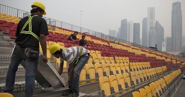 Singapore schools, F1 race on edge as bad haze persists